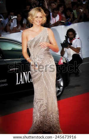 VENICE, ITALY - AUGUST 29: Actress Charlize Theron attends The Burning Plain premiere held at the Sala Grande during the 65th Venice Film Festival on August 29, 2008 in Venice, Italy - stock photo