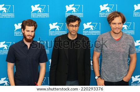 VENICE, ITALY - AUGUST 29: Andrew Garfield, Ramin Bahrani and actor Michael Shannon attend the '99 Homes' photocall during the 71st Venice Film Festival in August 29, 2014 in Venice, Italy  - stock photo