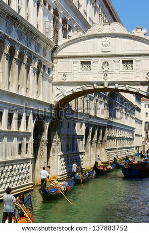 VENICE, ITALY - AUGUST 21: Bridge of Sighs and tourists on gondolas along the canals on August 21, 2012 in Venice, Italy.
