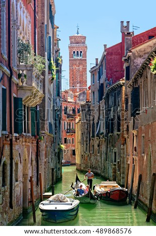 Venice, Italy - August 11, 2016: Canal with gondola in Venice. For centuries the gondola was the chief means of transportation and most common watercraft within Venice.
