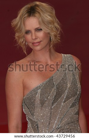 VENICE, ITALY - AUGUST 29: Charlize Theron arrives at the Premiere of 'The Burning Plain' Film for the 65th Venice Film Festival. - stock photo