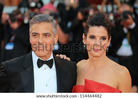 VENICE, ITALY - AUGUST 28: George Clooney and Sandra Bullock attend 'Gravity' Premiere and Opening Ceremony during the 70th Venice International Film Festival  on August 28, 2012 in Venice, Italy  - stock photo