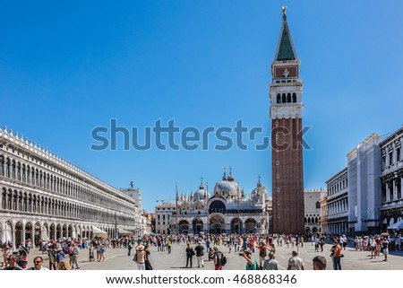 VENICE, ITALY - AUGUST 11, 2016: Tourists in the World famous Piazza San Marco (St Mark's Square) - the principal public square of Venice.