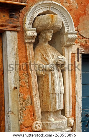 Venice, Italy, campo dei Mori detail: one of the Mori statue - stock photo