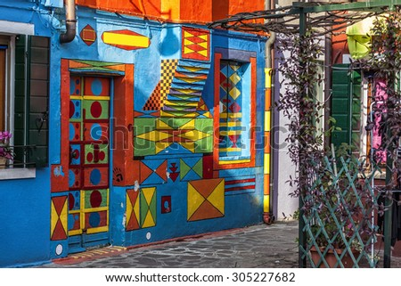 VENICE, ITALY- CIRCA NOVEMBER 2013: House painted all the colors in Murano - stock photo