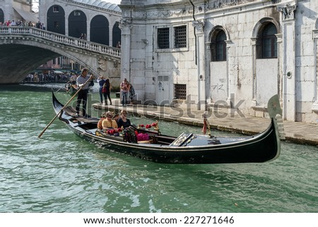 VENICE, ITALY/EUROPE - OCTOBER 12 : Gondolier ferrying people in Venice Italy on October 12, 2014. Unidentified people.