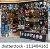VENICE,ITALY- FEBRUARY 19:A shop full of traditional masks and souvenirs in a small street,in the Carnival days on February 19,2012. During the Carnival people wear masks to conceal their identity. - stock photo