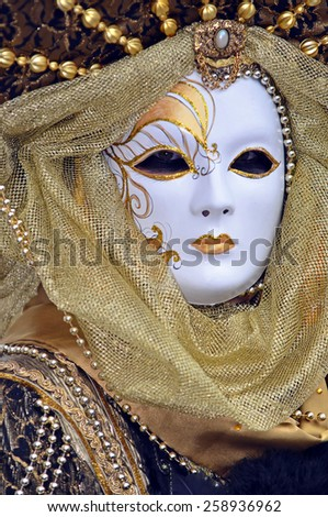 VENICE, ITALY - FEBRUARY 12: Carnival masked costume in gold and pearls at the 2015 Venice Carnival:  February  12, 2015 in Venice, Italy