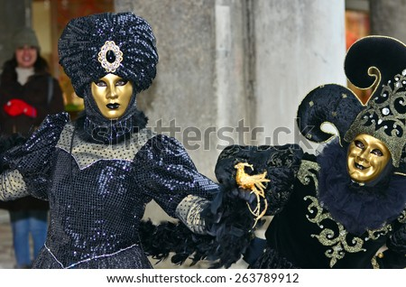 VENICE, ITALY - FEBRUARY 12: Dark blue clad lady with black jester at the 2015 Venice Carnival:  February  12, 2015 in Venice, Italy