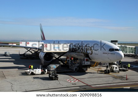 VENICE, ITALY - FEBRUARY 06: Emirates Boeing 777 at Venice Airport on February 06, 2014 in Venice, Italy. Emirates is one of the biggest airline in the world with roughly 2400 flights per week. - stock photo