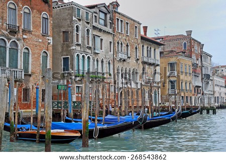 VENICE, ITALY-FEBRUARY 14, 2007: gondoliers and gondola for tourists along the Grand canal. Venice is a great tourists attraction with more than 27 million tourists every year. - stock photo