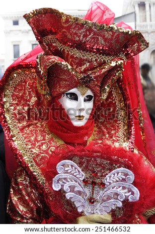 VENICE, ITALY - FEBRUARY 19: Person in typical Venetian costume - mask - attends the Carnival of Venice. The Carnival on February 19, 2006 in Venice, Italy. - stock photo