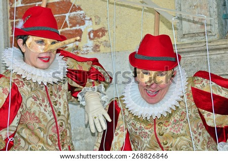 VENICE, ITALY - FEBRUARY 12: Pinocchio matched costumes at the 2015 Venice Carnival:  February  12, 2015 in Venice, Italy - stock photo