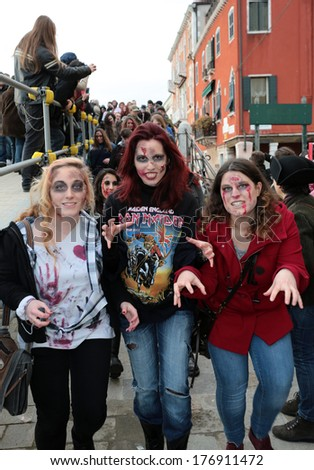 VENICE, ITALY - FEBRUARY 15: Public performance Zombie walk open the Venice carnival walking around Venice city on February 15, 2014 in Venice, Italy