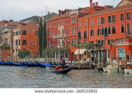 VENICE, ITALY-FEBRUARY 14, 2007: tourists in gondola in the grand canal at sunset. Venice is a great tourists attraction with more than 27 million tourists every year. - stock photo
