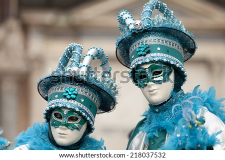 Venice, Italy - February 11, 2012: Two wonderful participant of the annual carnival. Carnival is one of the oldest traditional feasts of Venice. - stock photo