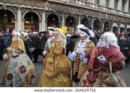 VENICE, ITALY - FEBRUARY 8, 2015: Unidentified masked persons in costume on San Marco Square during the Carnival in Venice, Italy. - stock photo