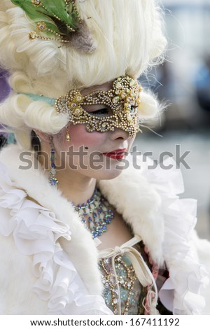 VENICE, ITALY - FEBRUARY 9: Unidentified person with Venetian carnival mask in Venice, Italy on February 9, 2013. At 2013 it is held from January 26th to February 12th.