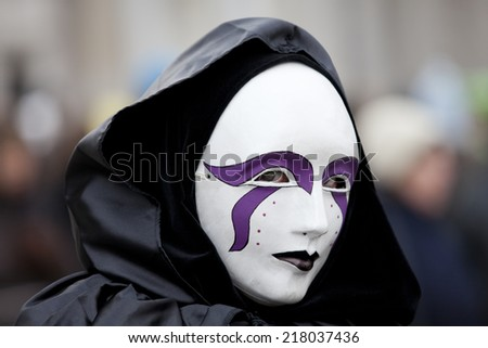 Venice, Italy - February 11 2012: Woman with typical venetian carnival costume at the Carnival of Venice. Shot in St. Mark's Square.