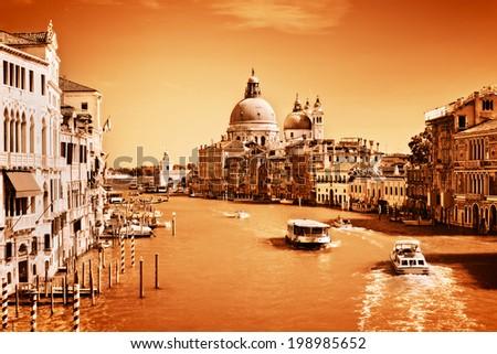 Venice, Italy. Grand Canal and Basilica Santa Maria della Salute at sunny day. View from Ponte dell Accademia. Vintage, monochrome gold - stock photo