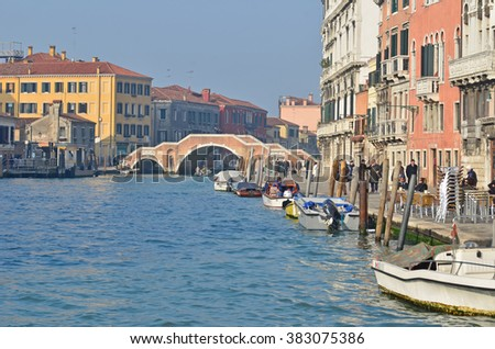 VENICE, ITALY - JANUARY 27: Pedestrians and boats along the Rio di Noale in Venice with one of its bridges: January 27, 2016 in Venice, Italy - stock photo