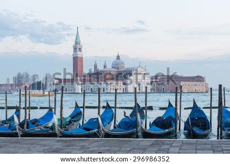 Venice, Italy. January 27, 2015 Venice View with famous gondolas at blue sunset.
