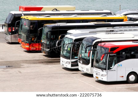 VENICE, ITALY - JULY 30, 2014: Interurban coaches at the touristic bus station. - stock photo