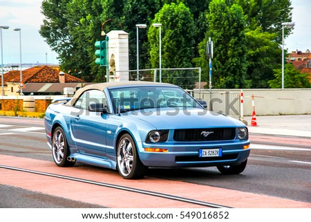 VENICE, ITALY - JULY 30, 2014: Motor car Ford Mustang in the city street.