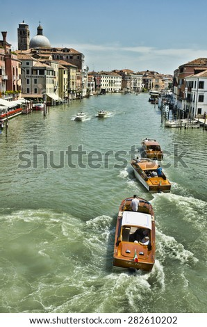 VENICE, ITALY - JUNE 6: boats on the Grand Canal on June 6, 2013 in Venice, Italy. Venice is one of the world's most popular tourist destinations with 21 million visitors per annum.  - stock photo