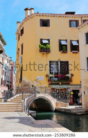 VENICE, ITALY - 26 JUNE, 2014: City canal in Venice - stock photo
