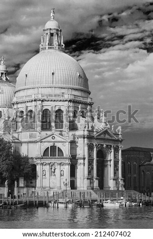 VENICE, ITALY - JUNE 6: Santa Maria della Salute church on June 6, 2013 in Venice, Italy. Venice is one of the world's most popular tourist destinations with 21 million visitors per annum. - stock photo