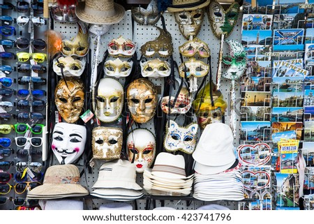VENICE, ITALY, JUNE 19, 2014: Souvenirs and carnival masks, stylish sunglasses and postcards on street trading in Venice, Italy - stock photo