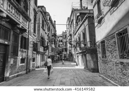 VENICE, ITALY - JUNE 26, 2014: Street of old Venice, Italy.. Black and white photography.