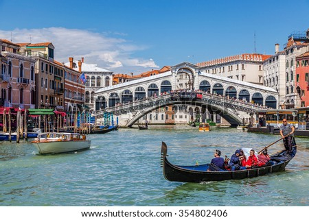 Venice, Italy  JUNE 05, 2013: Tourists make a walk to the gondola at the Grand Canal - stock photo