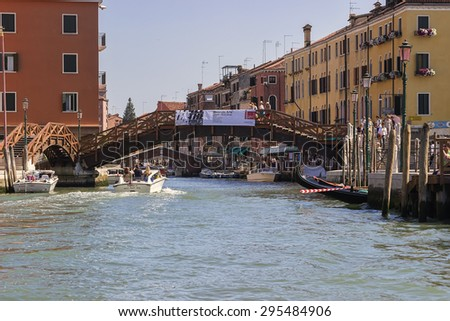 VENICE, ITALY - JUNE 30, 2015: View from Grand Canal on surrounding bridges and old houses, colored photo.
