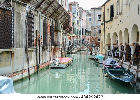 VENICE, ITALY - JUNE 04, 2016 -  view of the canals of Venice with small bridges and buildings that are reflected in the canals that run through the most romantic city in the world in Italy