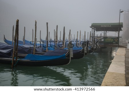VENICE, Italy, March 19 2016: Foggy morning in Venice. Dock for gondola on the Grand Canal in Venice.