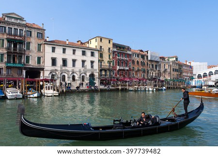 Venice, Italy - March 20, 2016: Traditional Gondola with tourists at Venice grand canal. The Gondola is a traditional Venetian rowing boat, well suited to the conditions of the Venetian lagoon