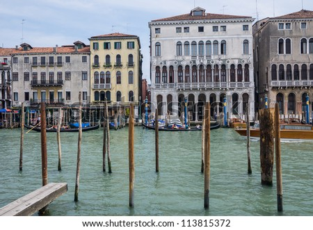 VENICE, ITALY - MAY 11: Gondola's passing some of the palaces along the Grand Canal in Venice on May 11, 2012. The Grand Canal, the city's main traffic corridor, flows in an S-shape. - stock photo