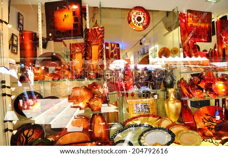 VENICE, ITALY - MAY 6, 2012: Murano glass on display in window shop in Rialto market, Venice. Murano glass is a famous product of the Venetian island of Murano, traditional manufacturing centre. - stock photo