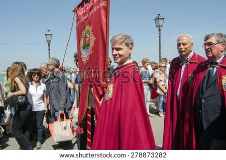 VENICE, ITALY - MAY 17, 2015:  The Scuola Dalmata dei SS Giorgio e Trifone parading on Lido as part of the Festa della Sensa.  The Ascension Day event includes the Marriage of the Sea ceremony. - stock photo