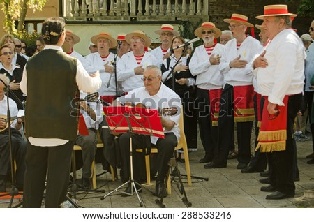 VENICE, ITALY - MAY 17, 2015:  Traditional Venetian folk singers and musicians performing during the Festa della Sensa celebrations marking the city's annual marriage to the sea.   - stock photo