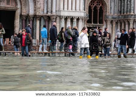 VENICE, ITALY - NOVEMBER 01: Venice flooded from the  high water of the 2012 season in November 01, 2012 in Venice, Italy - stock photo