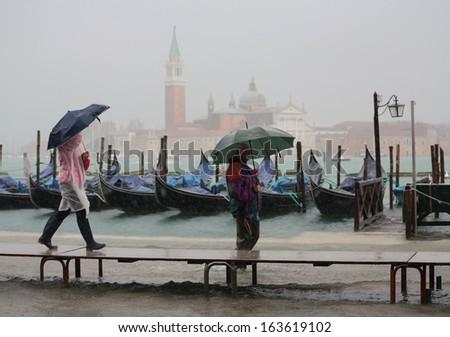 VENICE, ITALY - NOVEMBER 19: Venice flooded from the high water of the 2013 season in November 19, 2013 in Venice, Italy  - stock photo
