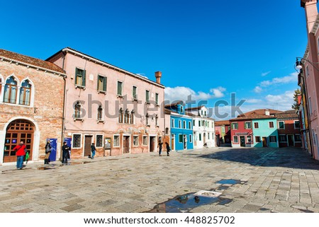VENICE, ITALY - 17 OCTOBER 2015: Market square in famous Burano with its colorful houses near Venice, Italy - stock photo