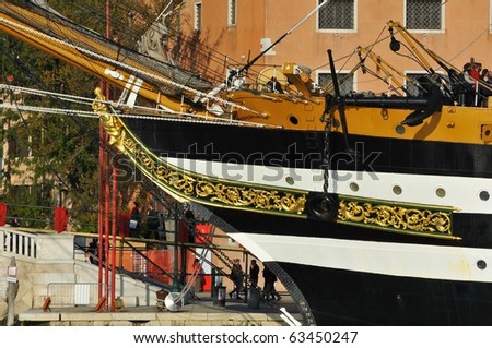 VENICE, ITALY - OCTOBER 20: The tall ship the Amerigo Vespucci docked in Venice showing the figurehead the ships namesake:  October 20, 2010 in Venice Italy