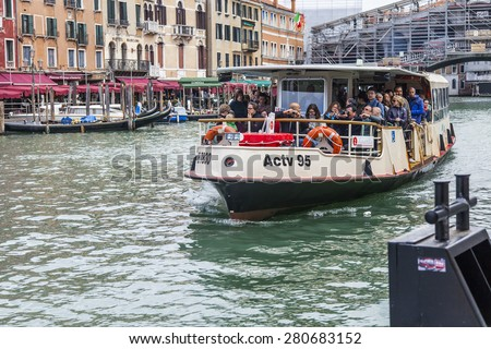 VENICE, ITALY - on APRIL 29, 2015. Vaporetto with passengers floats on the Grand channel (Canal Grande). Vaporetto - public transport in island part of Venice