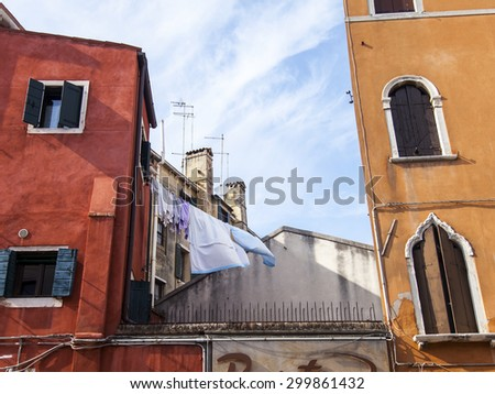 VENICE, ITALY - on MAY 4, 2015. A fragment of a facade of a typical house in island part of the city - stock photo