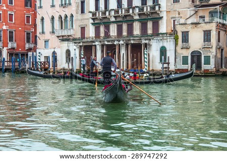 VENICE, ITALY - on MAY 1, 2015. Gondolas and trogetto with passengers float on the Grand channel (Canal Grande).