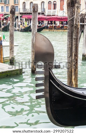 VENICE, ITALY - on MAY 4, 2015. The gondola moored at the coast of the Grand channel (Canal Grande) - stock photo